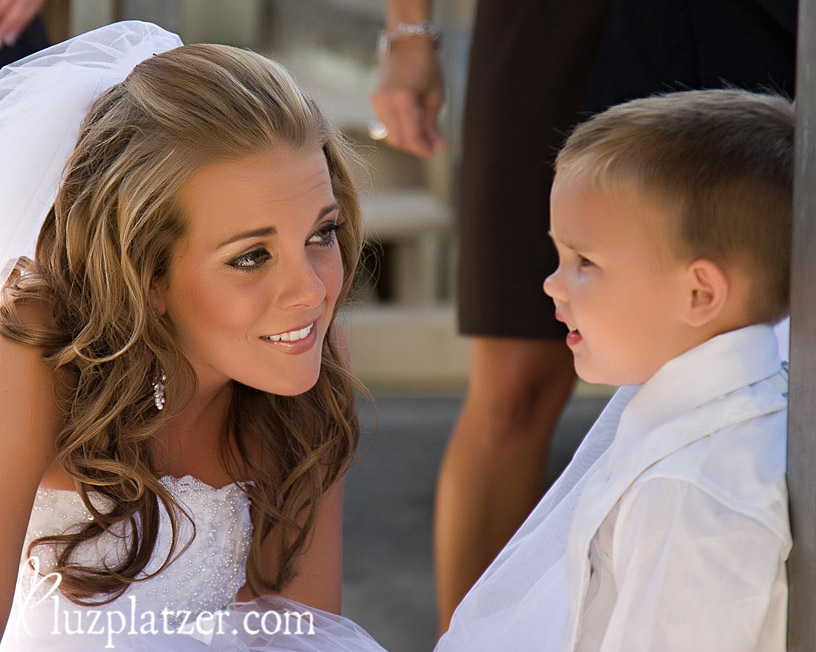 bride and little groomsman