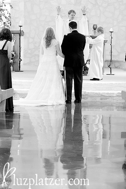 Reflection of bride and groom at the altar
